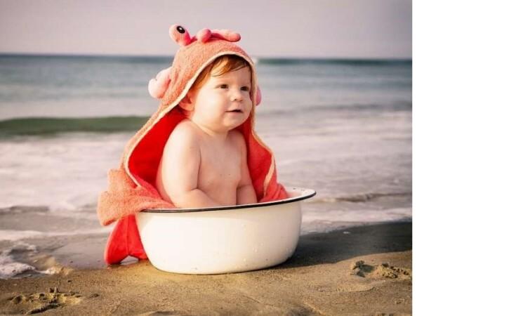 Bambini a rischio melanoma, No assoluto ai neonati in spiaggia
